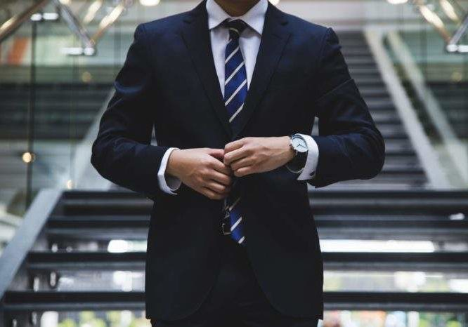 businessman standing in pressed new suit